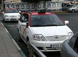 Two taxis waiting in a taxi rank